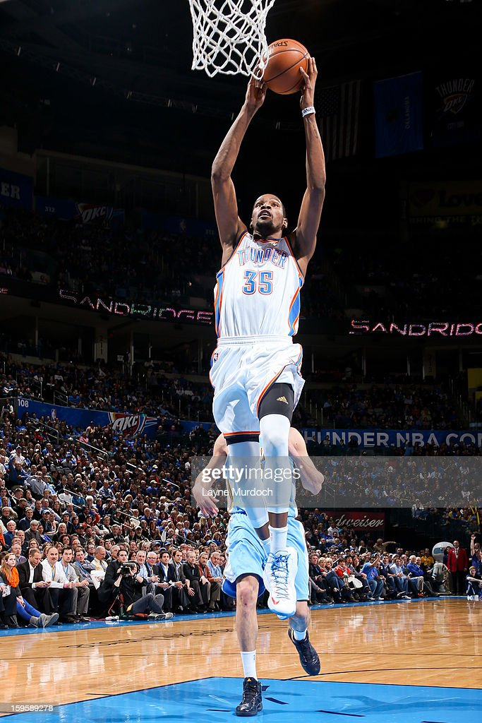 Kevin Durant #35 of the Oklahoma City Thunder dunks against the Denver Nuggets on January 16, 2013 at the Chesapeake Energy Arena in Oklahoma City, Oklahoma.