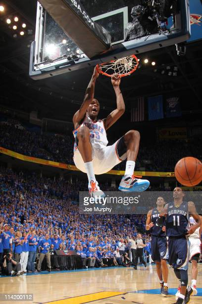 Kevin Durant of the Oklahoma City Thunder dunks against the Memphis Grizzlies during Game Seven of the Western Conference Semifinals in the 2011 NBA...