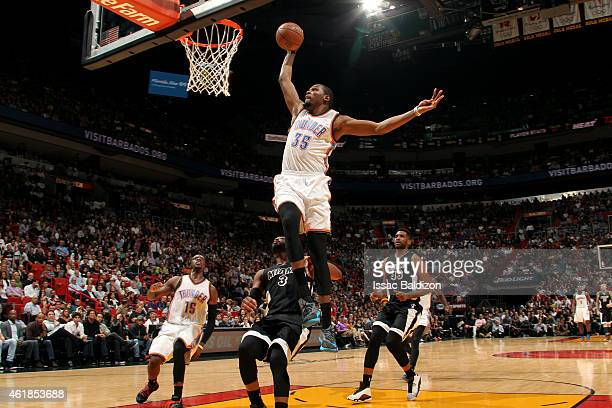 Kevin Durant of the Oklahoma City Thunder dunks against the Miami Heat on January 20 2015 at American Airlines Arena in Miami Florida NOTE TO USER...