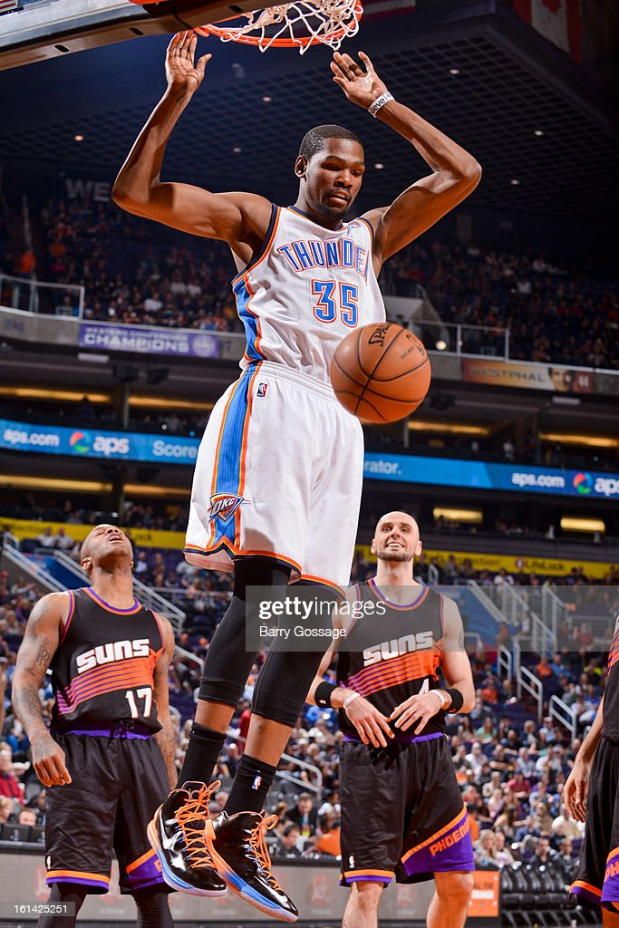 Kevin Durant #35 of the Oklahoma City Thunder dunks against the Phoenix Suns on February 10, 2013 at U.S. Airways Center in Phoenix, Arizona.