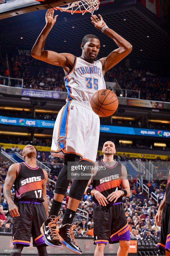 Kevin Durant #35 of the Oklahoma City Thunder dunks against the Phoenix Suns on February 10, 2013 at U.S. Airways Center in Phoenix, Arizona.