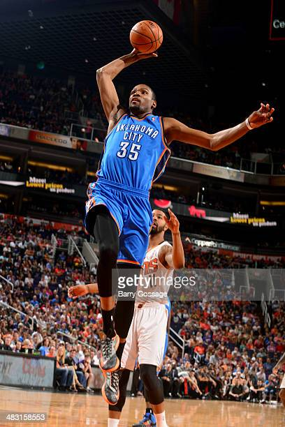 Kevin Durant of the Oklahoma City Thunder dunks against the Phoenix Suns on April 6 2014 at US Airways Center in Phoenix Arizona NOTE TO USER User...