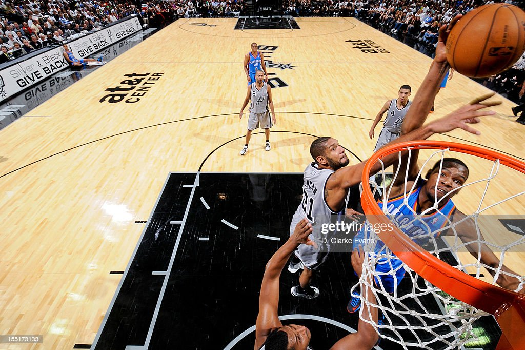 <a gi-track='captionPersonalityLinkClicked' href=/galleries/search?phrase=Kevin+Durant&family=editorial&specificpeople=3847329 ng-click='$event.stopPropagation()'>Kevin Durant</a> #35 of the Oklahoma City Thunder dunks against <a gi-track='captionPersonalityLinkClicked' href=/galleries/search?phrase=Tim+Duncan&family=editorial&specificpeople=201467 ng-click='$event.stopPropagation()'>Tim Duncan</a> #21 of the San Antonio Spurs on November 1, 2012 at the AT&T Center in San Antonio, Texas.