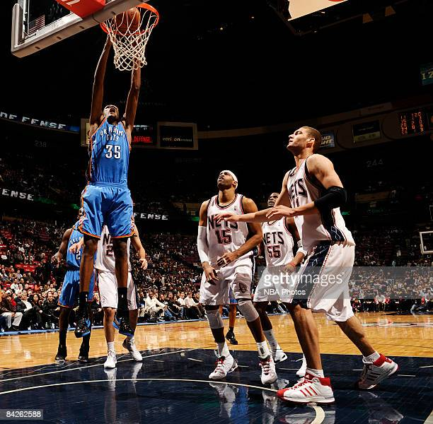 Kevin Durant of the Oklahoma City Thunder dunks against Vince Carter Keyon Dooling and Brook Lopez of the New Jersey Nets on January 12 2009 at the...
