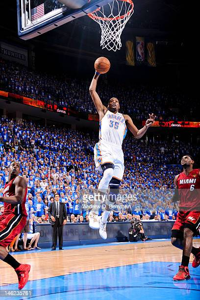 Kevin Durant of the Oklahoma City Thunder dunks ahead of LeBron James of the Miami Heat during Game One of the 2012 NBA Finals at Chesapeake Energy...