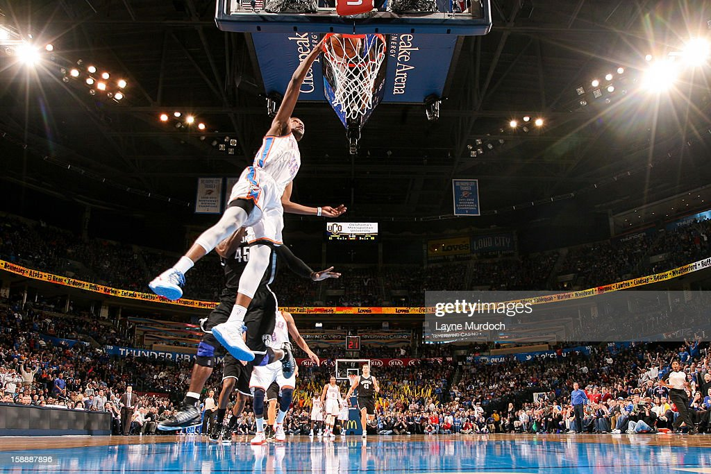 Kevin Durant #35 of the Oklahoma City Thunder dunks on a fast break against the Brooklyn Nets on January 2, 2013 at the Chesapeake Energy Arena in Oklahoma City, Oklahoma.