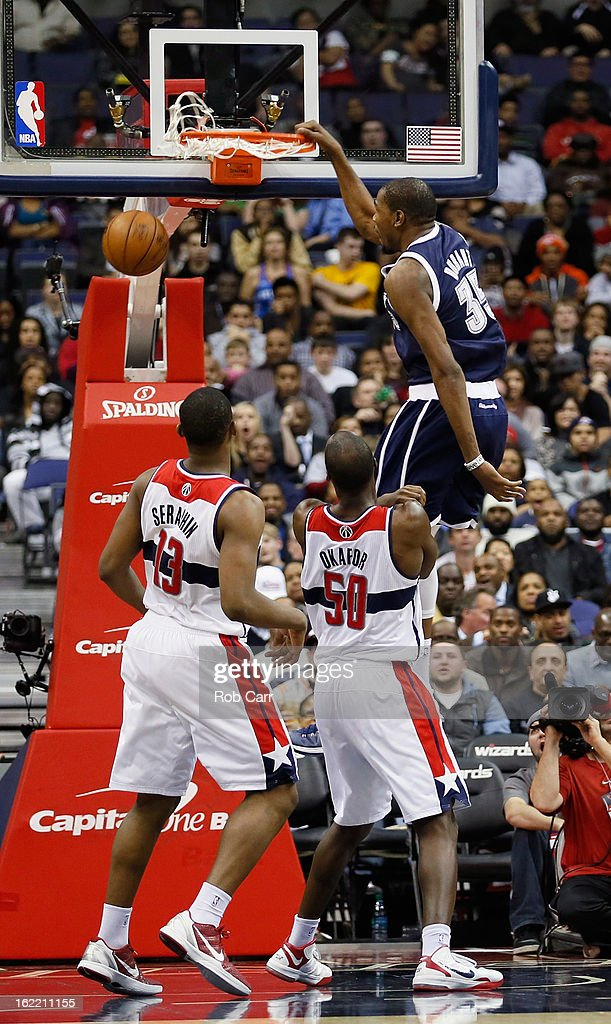 Kevin Durant #35 of the Oklahoma City Thunder dunks over Kevin Seraphin #13 and Emeka Okafor #50 of the Washington Wizards during the second half at Verizon Center on January 7, 2013 in Washington, DC.