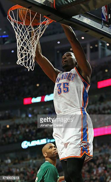 Kevin Durant of the Oklahoma City Thunder dunks over Taj Gibson of the Chicago Bulls at the United Center on March 17 2014 in Chicago Illinois NOTE...
