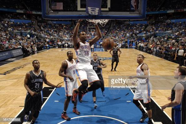 Kevin Durant of the Oklahoma City Thunder dunks the ball home against the Orlando Magic during the game on March 22 2013 at Amway Center in Orlando...