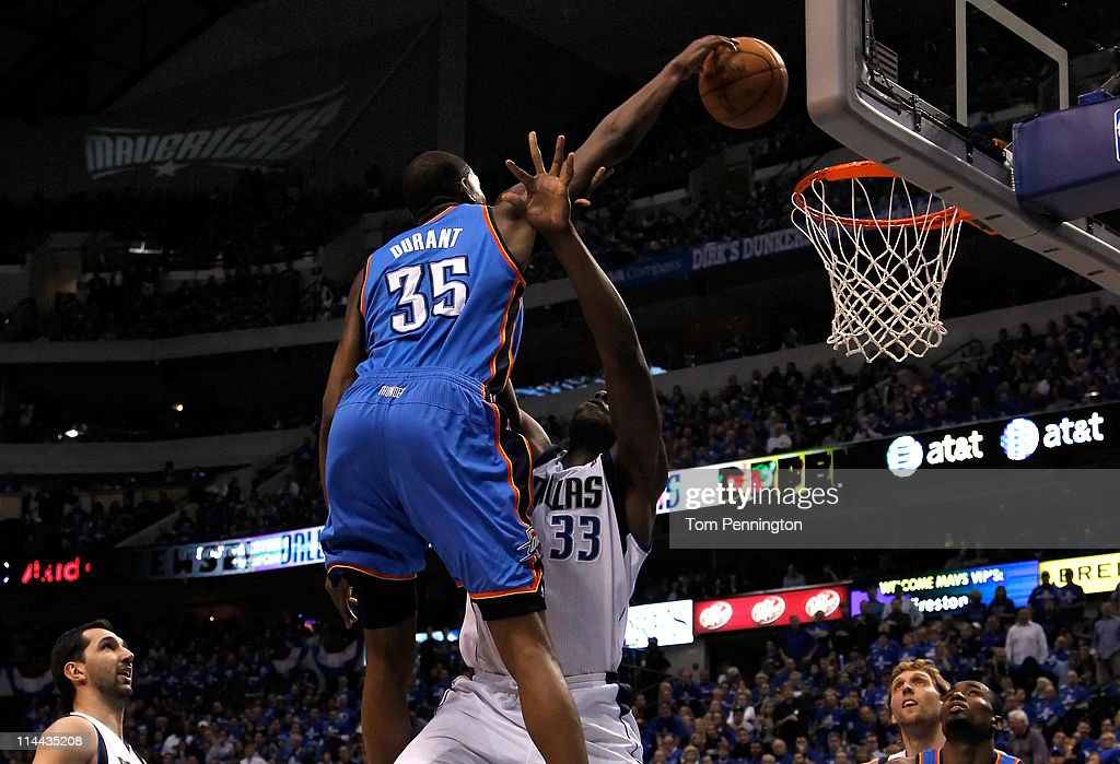 Kevin Durant of the Oklahoma City Thunder dunks the ball over Brendan Haywood of the Dallas Mavericks as Haywood is called for a foul in the first...