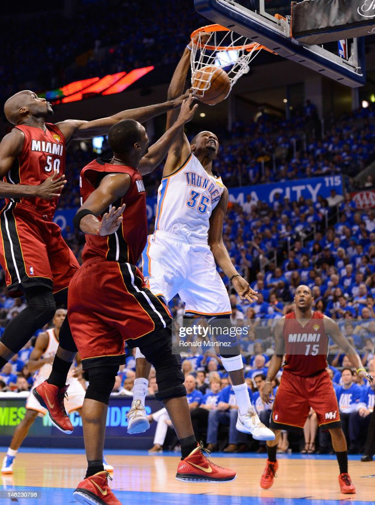 <a gi-track='captionPersonalityLinkClicked' href=/galleries/search?phrase=Kevin+Durant&family=editorial&specificpeople=3847329 ng-click='$event.stopPropagation()'>Kevin Durant</a> #35 of the Oklahoma City Thunder dunks the ball over <a gi-track='captionPersonalityLinkClicked' href=/galleries/search?phrase=Joel+Anthony&family=editorial&specificpeople=4092295 ng-click='$event.stopPropagation()'>Joel Anthony</a> #50 and <a gi-track='captionPersonalityLinkClicked' href=/galleries/search?phrase=Chris+Bosh&family=editorial&specificpeople=201574 ng-click='$event.stopPropagation()'>Chris Bosh</a> #1 of the Miami Heat in the second quarter in Game One of the 2012 NBA Finals at Chesapeake Energy Arena on June 12, 2012 in Oklahoma City, Oklahoma.
