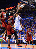 Kevin Durant of the Oklahoma City Thunder dunks the ball over Joel Anthony and Chris Bosh of the Miami Heat in the second quarter in Game One of the...