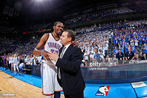 Kevin Durant of the Oklahoma City Thunder embraces head coach Scott Brooks after defeating the Los Angeles Lakers in Game Two of the Western...