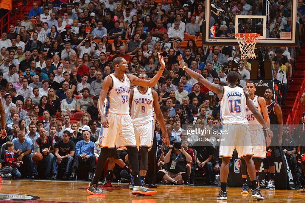 Kevin Durant #35 of the Oklahoma City Thunder gives a high five to teammate Reggie Jackson #15 against the Miami Heat at the American Airlines Arena in Miami, Florida on Jan. 29, 2014.