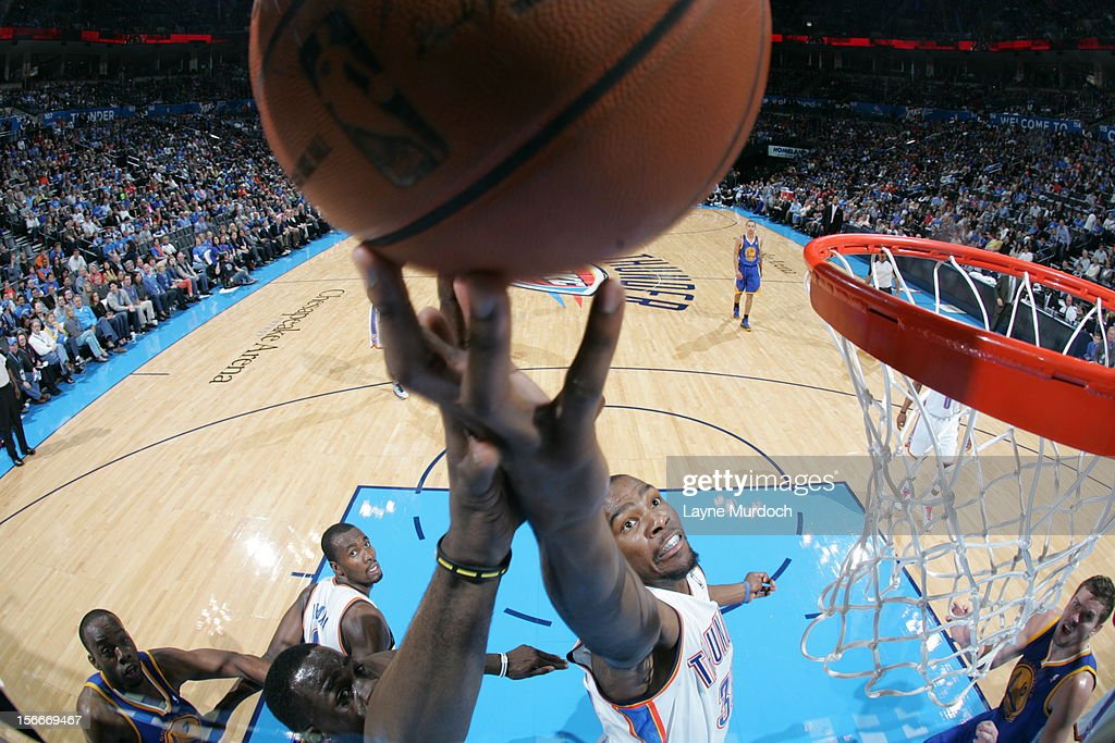 <a gi-track='captionPersonalityLinkClicked' href=/galleries/search?phrase=Kevin+Durant&family=editorial&specificpeople=3847329 ng-click='$event.stopPropagation()'>Kevin Durant</a> #35 of the Oklahoma City Thunder goes to the basket during the game between the Oklahoma City Thunder and the Golden State Warriors on November 18, 2012 at the Chesapeake Energy Arena in Oklahoma City, Oklahoma.