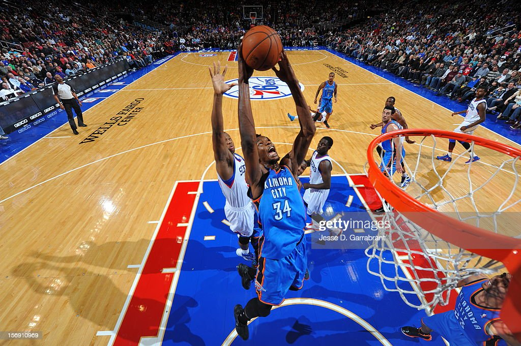 Kevin Durant #34 of the Oklahoma City Thunder goes up for a dunk against the Philadelphia 76ers during the game at the Wells Fargo Center on November 24, 2012 in Philadelphia, Pennsylvania.