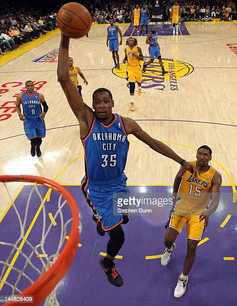 Kevin Durant of the Oklahoma City Thunder goes up for a dunk in front of Metta World Peace of the Los Angeles Lakers in the first half in Game Four...