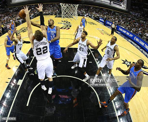Kevin Durant of the Oklahoma City Thunder goes up for a shot against Tiago Splitter of the San Antonio Spurs in the first half in Game Two of the...
