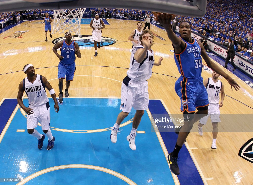 Kevin Durant #35 of the Oklahoma City Thunder goes up for a shot in front of Dirk Nowitzki #41 of the Dallas Mavericks in the first half in Game One of the Western Conference Finals during the 2011 NBA Playoffs at American Airlines Center on May 17, 2011 in Dallas, Texas.