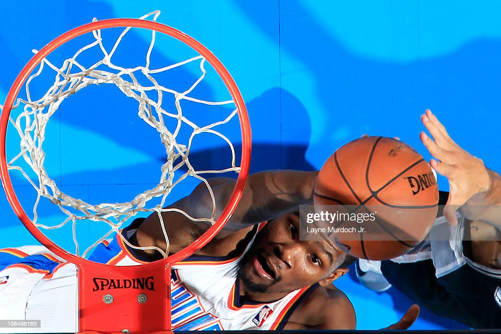 <a gi-track='captionPersonalityLinkClicked' href=/galleries/search?phrase=Kevin+Durant&family=editorial&specificpeople=3847329 ng-click='$event.stopPropagation()'>Kevin Durant</a> #35 of the Oklahoma City Thunder goes up for the easy bucket against the San Antonio Spurs during an NBA game on December 17, 2012 at the Chesapeake Energy Arena in Oklahoma City, Oklahoma.