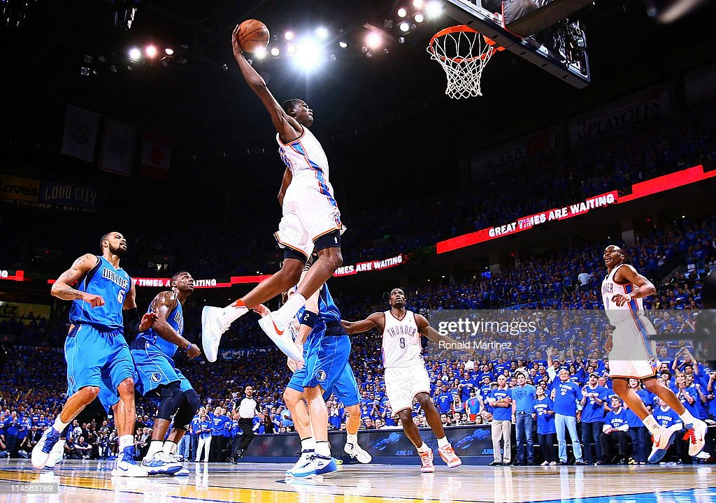 <a gi-track='captionPersonalityLinkClicked' href=/galleries/search?phrase=Kevin+Durant&family=editorial&specificpeople=3847329 ng-click='$event.stopPropagation()'>Kevin Durant</a> #35 of the Oklahoma City Thunder goes up to dunk the ball in the first quarter against the Dallas Mavericks in Game Four of the Western Conference Finals during the 2011 NBA Playoffs at Oklahoma City Arena on May 23, 2011 in Oklahoma City, Oklahoma.