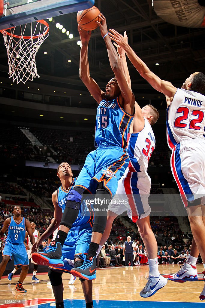Kevin Durant #35 of the Oklahoma City Thunder grabs a rebound against Jonas Jerebko #33 and Tayshaun Prince #22 of the Detroit Pistons on November 12, 2012 at The Palace of Auburn Hills in Auburn Hills, Michigan.