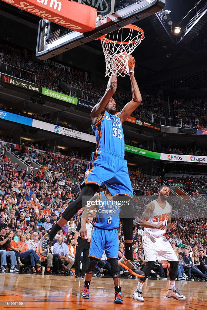 Kevin Durant #35 of the Oklahoma City Thunder grabs a rebound against the Phoenix Suns on April 6, 2014 at U.S. Airways Center in Phoenix, Arizona.