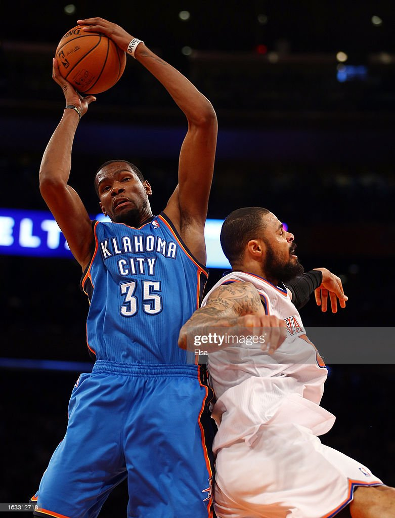 Kevin Durant #35 of the Oklahoma City Thunder grabs the rebound before Tyson Chandler #6 of the New York Knicks on March 7, 2013 at Madison Square Garden in New York City. The Oklahoma City Thunder defeated the New York Knicks 95-94.