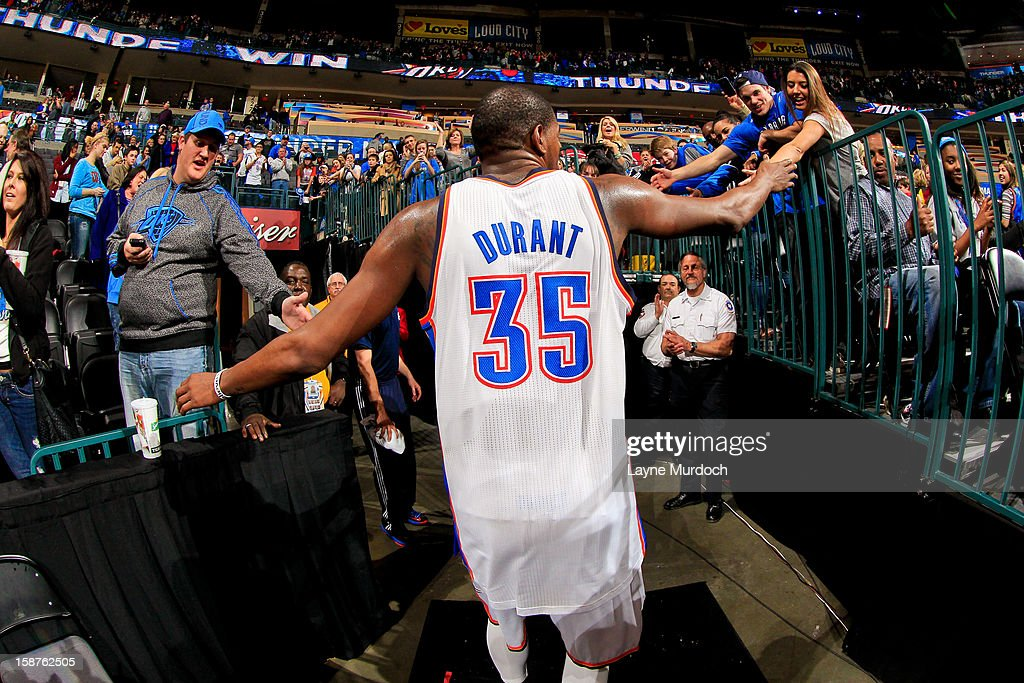 Kevin Durant #35 of the Oklahoma City Thunder greets fans following his team's overtime victory against the Dallas Mavericks on December 27, 2012 at the Chesapeake Energy Arena in Oklahoma City, Oklahoma.