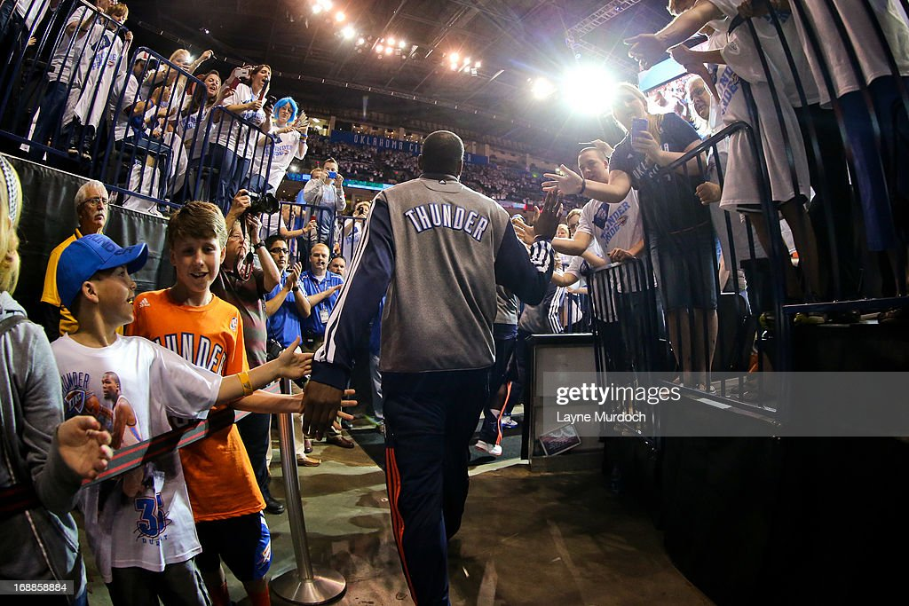 Kevin Durant #35 of the Oklahoma City Thunder greets fans on his way to the court to play against the Memphis Grizzlies in Game Five of the Western Conference Semifinals during the 2013 NBA Playoffs on May 15, 2013 at the Chesapeake Energy Arena in Oklahoma City, Oklahoma.