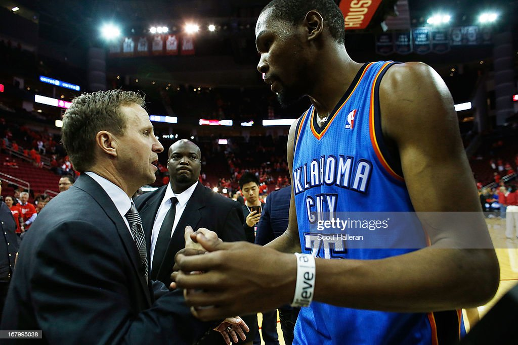 Kevin Durant #35 of the Oklahoma City Thunder greets his head coach Scott Brooks after the Thunder defeated the Houston Rockets 103-94 in Game Six of the Western Conference Quarterfinals of the 2013 NBA Playoffs at the Toyota Center on May 3, 2013 in Houston, Texas.