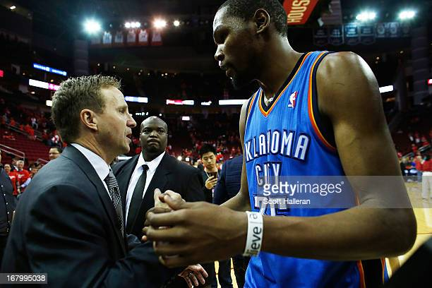Kevin Durant of the Oklahoma City Thunder greets his head coach Scott Brooks after the Thunder defeated the Houston Rockets 10394 in Game Six of the...