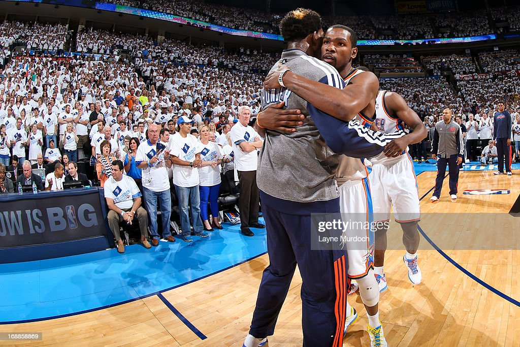 Kevin Durant #35 of the Oklahoma City Thunder greets teammate Hasheem Thabeet #34 before playing the Memphis Grizzlies in Game Five of the Western Conference Semifinals during the 2013 NBA Playoffs on May 15, 2013 at the Chesapeake Energy Arena in Oklahoma City, Oklahoma.