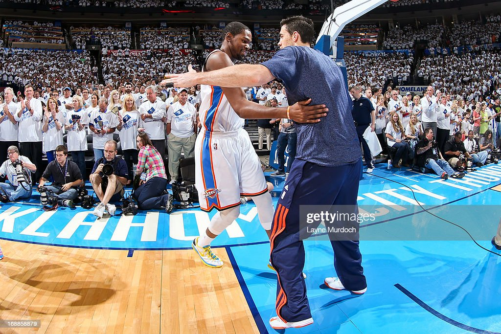 Kevin Durant #35 of the Oklahoma City Thunder greets teammate Nick Collison #4 before playing the Memphis Grizzlies in Game Five of the Western Conference Semifinals during the 2013 NBA Playoffs on May 15, 2013 at the Chesapeake Energy Arena in Oklahoma City, Oklahoma.