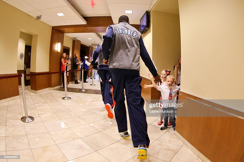Kevin Durant #35 of the Oklahoma City Thunder greets young fans on his way to the court to play against the Memphis Grizzlies in Game Five of the Western Conference Semifinals during the 2013 NBA Playoffs on May 15, 2013 at the Chesapeake Energy Arena in Oklahoma City, Oklahoma.