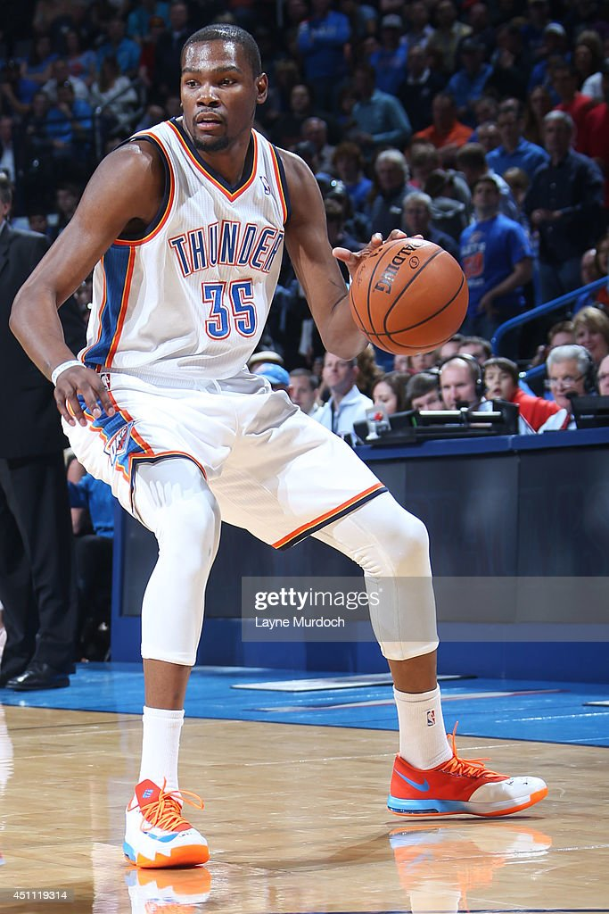 <a gi-track='captionPersonalityLinkClicked' href=/galleries/search?phrase=Kevin+Durant&family=editorial&specificpeople=3847329 ng-click='$event.stopPropagation()'>Kevin Durant</a> #35 of the Oklahoma City Thunder handles the ball against the Houston Rockets during an NBA game on March 11, 2014 at the Chesapeake Energy Arena in Oklahoma City, Oklahoma.