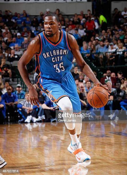 Kevin Durant of the Oklahoma City Thunder handles the ball against the Dallas Mavericks on October 10 2014 at the American Airlines Center in Dallas...
