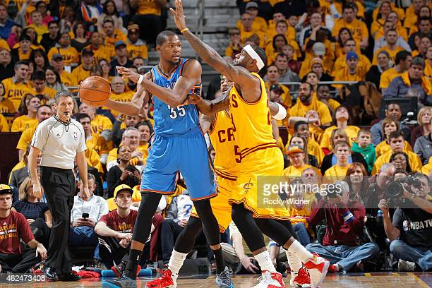 Kevin Durant of the Oklahoma City Thunder handles the ball against LeBron James of the Cleveland Cavaliers on January 25 2015 at Quicken Loans Arena...