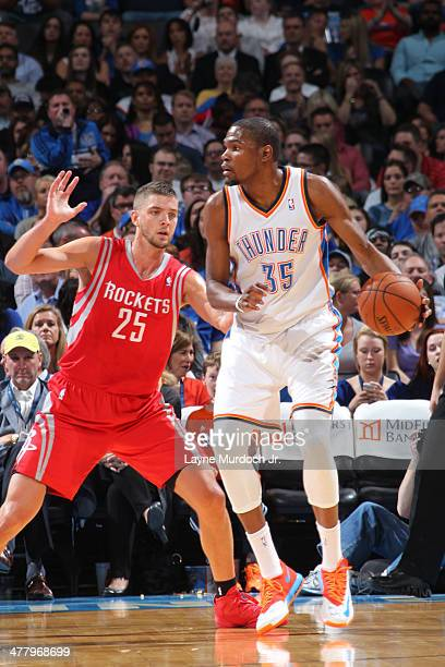 Kevin Durant of the Oklahoma City Thunder handles the ball against the Houston Rockets during an NBA game on March 11 2014 at the Chesapeake Energy...