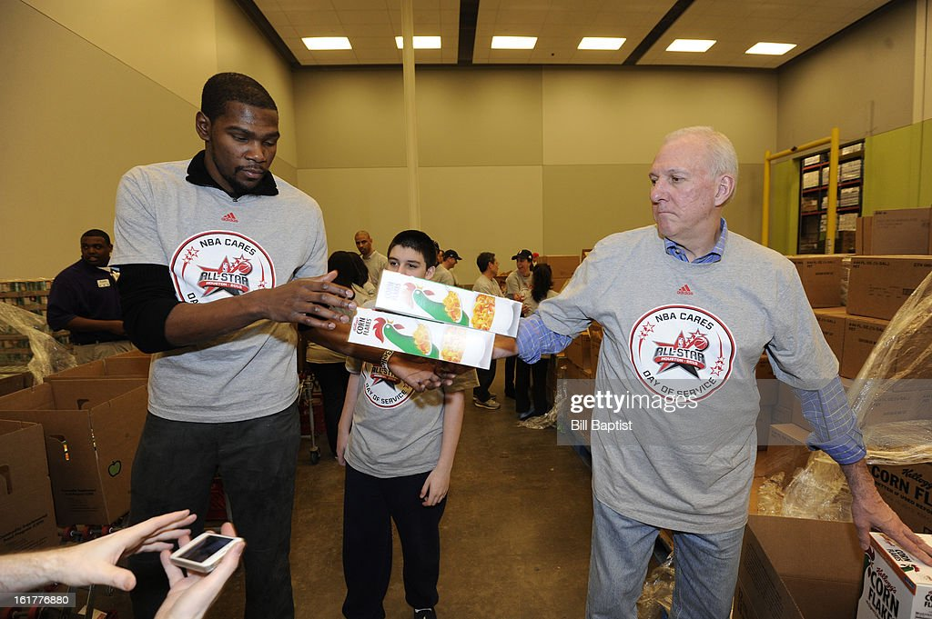 Kevin Durant #35 of the Oklahoma City Thunder helps out with Head Coach Gregg Popovich of the San Antonio Spurs pass boxes of cereal at the 2013 NBA Cares Day of Service at the Food Bank sorting on February 15, 2013 in Houston, Texas.