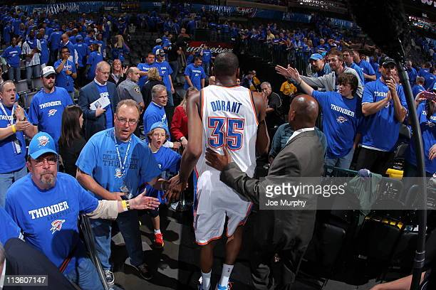 Kevin Durant of the Oklahoma City Thunder hifives the fans after defeating the Memphis Grizzlies in Game Two of the Western Conference Semifinals in...