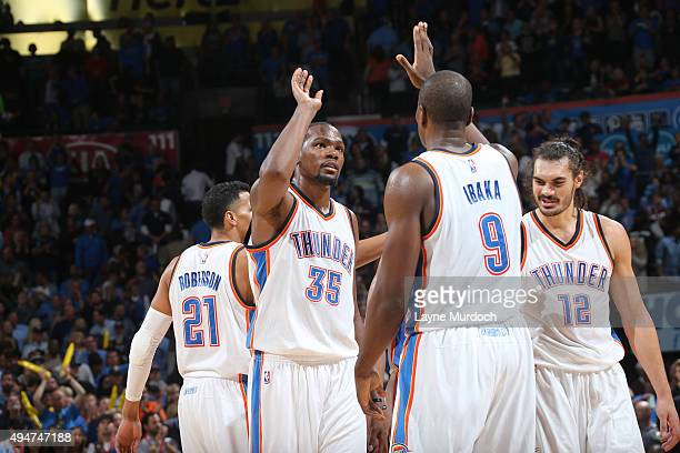 Kevin Durant of the Oklahoma City Thunder high fives Serge Ibaka of the Oklahoma City Thunder after the game against the San Antonio Spurs on October...