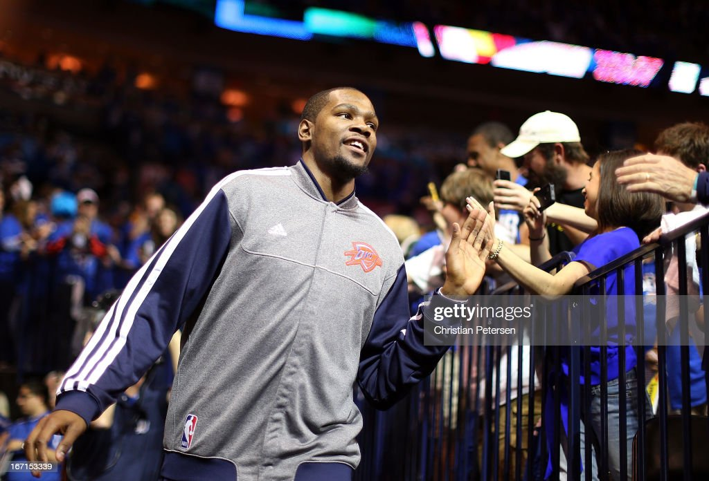 <a gi-track='captionPersonalityLinkClicked' href=/galleries/search?phrase=Kevin+Durant&family=editorial&specificpeople=3847329 ng-click='$event.stopPropagation()'>Kevin Durant</a> #35 of the Oklahoma City Thunder high fives fans as he runs out onto the court before Game One of the Western Conference Quarterfinals of the 2013 NBA Playoffs against the Houston Rockets at Chesapeake Energy Arena on April 21, 2013 in Oklahoma City, Oklahoma.