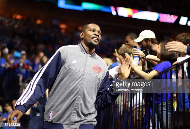 Kevin Durant of the Oklahoma City Thunder highfives fans as he runs out onto the court before Game One of the Western Conference Quarterfinals of the...