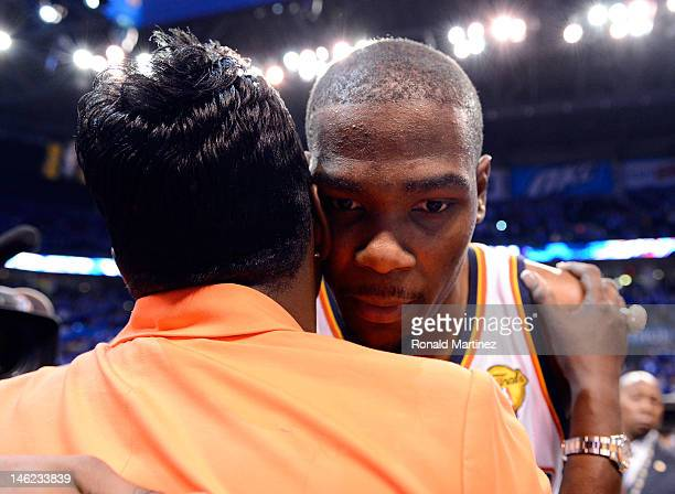 Kevin Durant of the Oklahoma City Thunder hugs his mother Wanda Pratt after the Thunder defeat the Miami Heat 10594 in Game One of the 2012 NBA...
