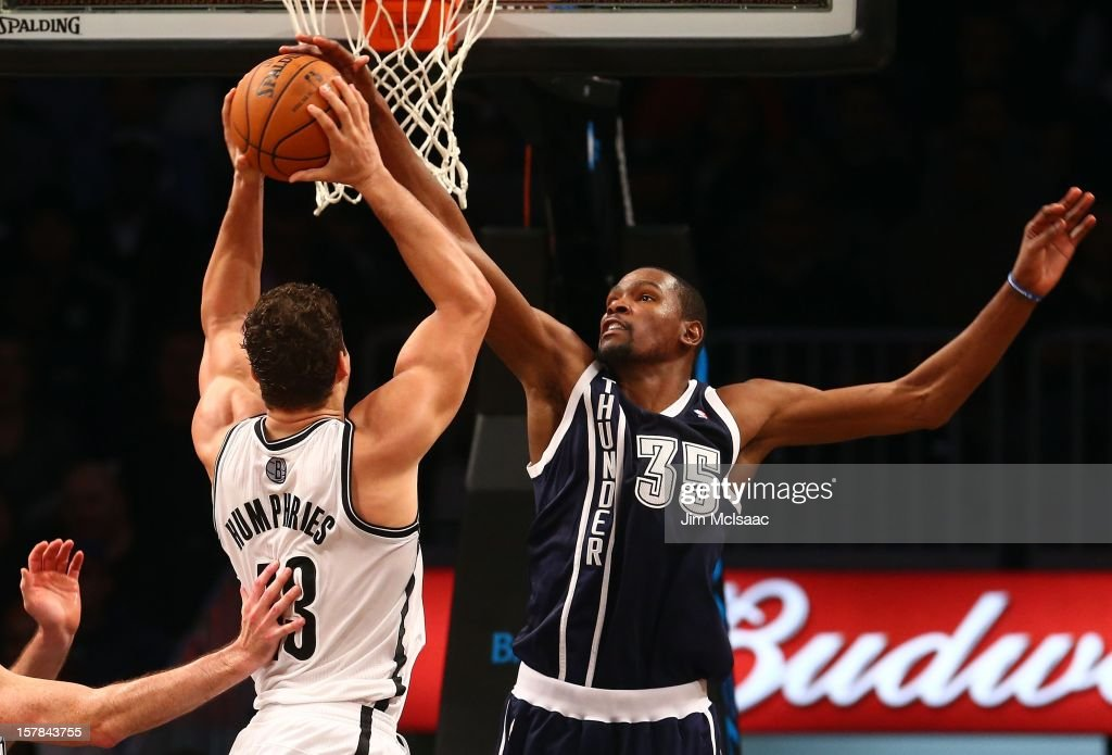 Kevin Durant #35 of the Oklahoma City Thunder in action against Kris Humphries #43 of the Brooklyn Nets at Barclays Center on December 4, 2012 in the Brooklyn borough of New York City.The Thunder defeated the Nets 117-111.
