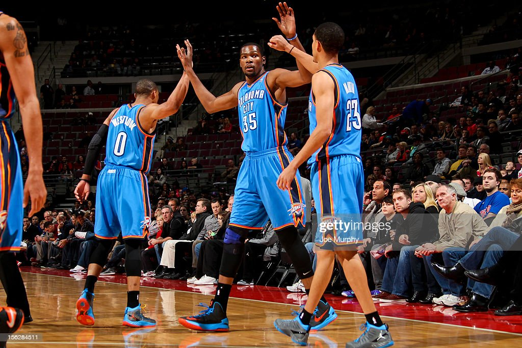 Kevin Durant #35 of the Oklahoma City Thunder is congratulated by teammates Russell Westbrook #0 and Kevin Martin #23 while playing the Detroit Pistons on November 12, 2012 at The Palace of Auburn Hills in Auburn Hills, Michigan.