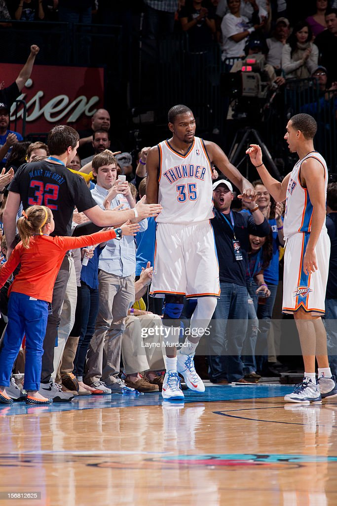Kevin Durant #35 of the Oklahoma City Thunder is congratulated by fans and teammate Kevin Martin #23 while playing the Los Angeles Clippers on November 21, 2012 at the Chesapeake Energy Arena in Oklahoma City, Oklahoma.