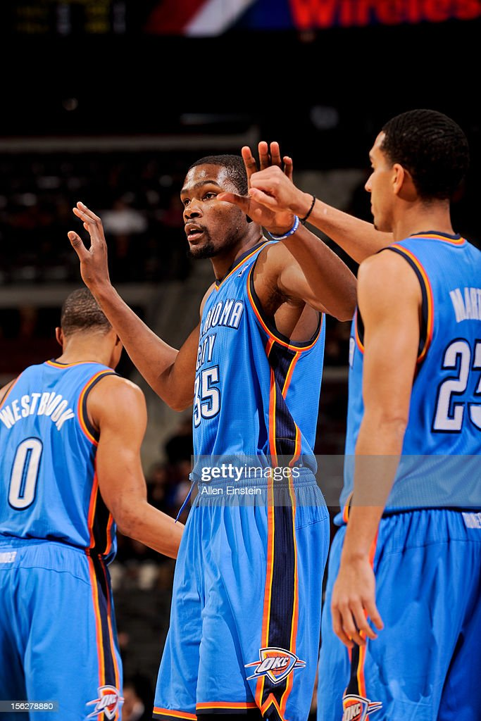 Kevin Durant #35 of the Oklahoma City Thunder is congratulated by teammate Kevin Martin #23 while playing against the Detroit Pistons on November 12, 2012 at The Palace of Auburn Hills in Auburn Hills, Michigan.