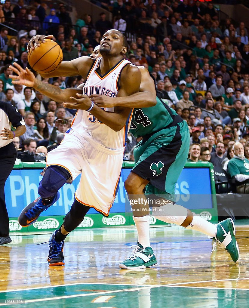 Kevin Durant #35 of the Oklahoma City Thunder is fouled while driving to the basket by Paul Pierce #34 of the Boston Celtics during the game on November 23, 2012 at TD Garden in Boston, Massachusetts.